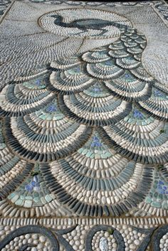 I suppose this should go in front of my fountain. Pebble mosaic pathway featured at the 2010 Chelsea Flower show. The peacock design is fantastic! Photo by Claire Ashman. Pebble Mosaic, Mosaic Art, Mosaic Glass, Rock Mosaic, Stone Mosaic, Mosaic Walkway, Tile Mosaics, Glass Tiles, Stone Tiles