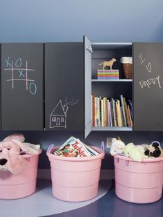 chalkboard cabinets and plastic bins for storage in kid's room