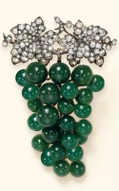 AN ANTIQUE DIAMOND AND GREEN CHALCEDONY BROOCH, CIRCA 1895. Designed as a cluster of vari-sized green chalcedony grapes, suspended by old European and old mine-cut diamond leaves and stem, mounted in silver and gold. #antique #brooch