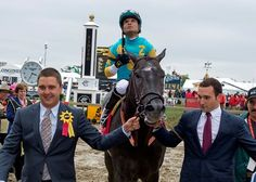 Undefeated Justin Squared retained that status with a front-running two-length victory in the $100,000 Chick Lang Stakes on the Xpressbet.com Preakness (gr. I) undercard May 21.