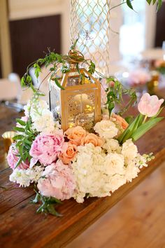 Gold Lantern With Lush Flower Garland   photography by http://www.krystleakin.com/