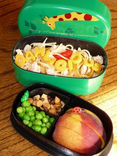 From Zoe's Lunchbox created this lunch based on some of Roald Dahl's most popular books:  wormy spaghetti with gummy worms (The Twits), chicken (Fantastic Mr. Fox), sharp cheddar cheese letters, peach slices (James & The Giant Peach), peas (The Witches), and cashews, butterscotch, and chocolate chips (Charlie & The Chocolate Factory) all in our giraffe lunch box (The Giraffe and the Pelly and Me).