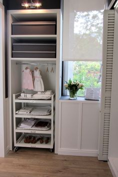Gorgeous laundry room with built-in storage and roll-out storage cart. Blue Laundry Rooms, Laundry Room Sink, Laundry Room Shelves, Laundry Room Design, Laundry Cart, Mud Rooms, Laundry Room Inspiration, Home Decor Inspiration, Laundry Room Doors