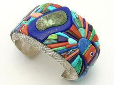 """Cuff   Alvin Yellowhorse (Navajo). Sterling silver Multi-Stone Cobble Inlay Featuring """"Chief of the Tribe"""" Design wearing Opal Necklace, Damali Turquoise, Coral, Lapis, and Intricate Corn Row Cobble Detail"""