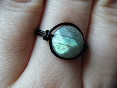 Hey, I found this really awesome Etsy listing at http://www.etsy.com/listing/92725652/faceted-labradorite-ring-black-wire