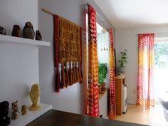 Dining room, owls, vintage macrame, grey walls, bold curtains.