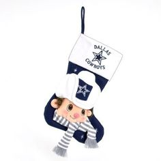 """$19.99-$37.50 Dallas Cowboys Christmas Stocking Item #11776 Officially licensed merchandise Baby stocking features the official team colors, with a plush baby mascot on the stocking and team logo on the cuff Comes ready-to-hang on a loop Dimensions: 22""""L Material(s): cotton blend"""