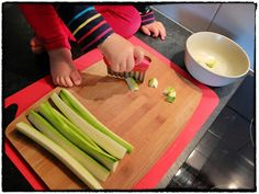cutting vegetables (at 20 months)