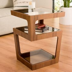 With contrasting veneer and glass shelves, this is a contemporary twist on a side table. 3 shelves provide all the storage youll need for beside your sofa or bed.