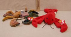 "Ty Beanie Babies 1993 Red Lobster Named ""Pinchers"" he is 9"" long x 7"" wide.  Ty Beanie Babies 1996 Multi-colored Crab named ""Claude"" 7"" long x 9 1/2"" wide. 