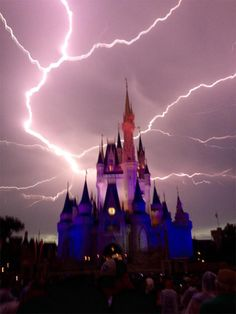Lightning strikes over Cinderella Castle at Disney World As a lightning storm rolled through Central Florida Magic Kingdom attendees captured what looks like a near miss to Cinderella Castle by a bolt. Dame Nature, Thunder And Lightning, Lightning Storms, Wild Weather, Tornados, Thunderstorms, Cinderella Castle, Lightning Strikes, Storm Clouds