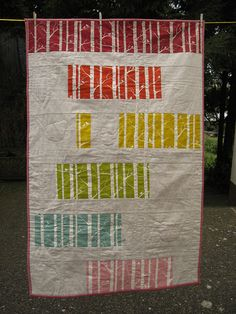 simple quilt with large pieces of the same fabric in several colors.  I like how the trees read as pieced stripes from a distance