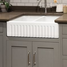 The Farmhouse double sink is a traditional, heavy-duty, fireclay sink it features a ribbed apron or plain fluted apron to give you both options to suit your kitchen theme. Designed to withstand heavy use, and is available in white. Note as Fireclay is a h Barn Sink, Fireclay Sink, Farmhouse Sink, Kitchen Themes, Rustic Furniture, Traditional Kitchen, Eclectic Tile, Fire Clay, Sink