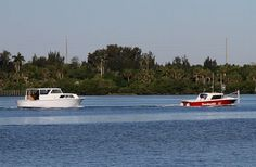 A Boat U.S. tow service vessel assists a boat owner in Indian River near the Indian River Aquatic Reserve