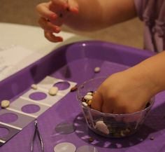 Fine Motor Activity using paint chip that focuses on eye/ hand coordination, color matching, and pincer grasp