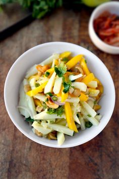 An easy, delicious and energizing spicy mango apple salad with authentic Thai flavors. Substitute green mango with granny smith apple for a healthy treat.