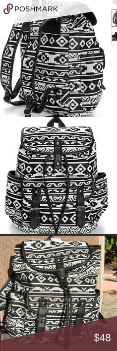 """Black and White Print w Black Trim Backpack Black and white print canvas rucksack backpack with black synthetic leather trim. Taffeta lining with cinch top and magnetic snap closures. Lightly padded adjustable shoulder straps and top handle loop. 14"""" H x 15"""" W x 6"""" D. 60% cotton, 40% polyester. NWT. Zippered inside pocket for your phone and keys. Outside pocket 7""""H x 9""""W x 2"""" D. Bags Backpacks"""