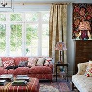 Pale Blue Living Room with Red Sofa