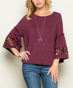 Intricate cutouts punctuate the breezy bell-sleeves of this top that radiates trend-savvy charm with slouchy dolman shoulders.