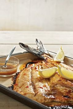 South African Snoek Fish With Apricot Jam _ Recipe from Martin van Deventer _ Snoek is delicious with a touch of sweetness and a mild spice like cumin. Try it in the oven or braai it outside. Read Recipe by Braai Recipes, Fish Recipes, Seafood Recipes, Cooking Recipes, Curry Recipes, South African Dishes, South African Recipes, Fish Dishes, Seafood Dishes
