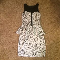 Crack Print Peplum Dress Black and white peplum dress with cracked pattern and sheer black chest and shoulder area. Super soft fabric, great for dances, worn once to a sports banquet. Tag says XS but fits S best or XS. Soprano Dresses Mini