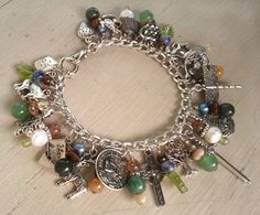 Outlander Series inspired charm bracelet by MistressJennie on Etsy, $65.00.  I SO NEED THIS!  My favorite series ever!!!