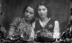 Sisters: These women pose together for photographer Costica Ascinte. Their photo is one of 1,000 that have been restored and digitised by Po...