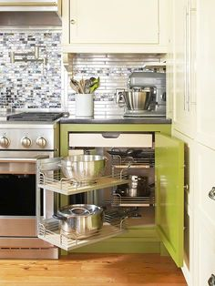 Expandable Space in your kitchen. This would be a dream! A pullout unit in a cabinet. via: http://www.bhg.com/kitchen/storage/organization/storage-packed-kitchens/#page=13