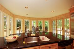 From the kitchen into the dining room, amazing views all around with these casement windows and patio doors from Renewal by Andersen Long Island