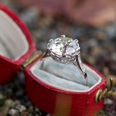 This magnificent low profile crown motif vintage diamond engagement ring features a 3 carat round brilliant cut center stone. 16 single cut diamonds and pieced gallery details complete this beautiful piece. The ring is currently a size 5 and we offer complimentary resizing to fit.