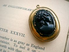 Vintage Large Black Cameo Gold Locket. I love Victorian style jewelry.