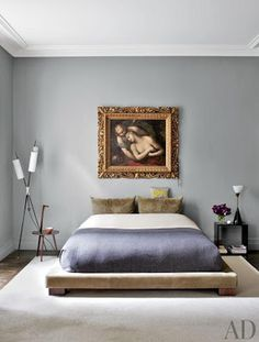 While fashion designer Stefano Pilati's Paris duplex is bursting with color and a treasure trove of antiques and artifacts, his master bedroom is artfully spare. The soft-gray walls highlight the Italian painting given to Pilati by his mother. Grey Room, Gray Bedroom, Master Bedroom, Bedroom Decor, Room Paint Colors, Paint Colors For Living Room, Architectural Digest, Ideas Dormitorios, Modern Floor Lamps