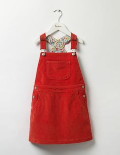 The traditional style of this dungaree dress is perfect with a Boden stripy top. It's hard-wearing enough for your running, jumping and skipping adventures. A pretty floral lining inside is an extra treat.