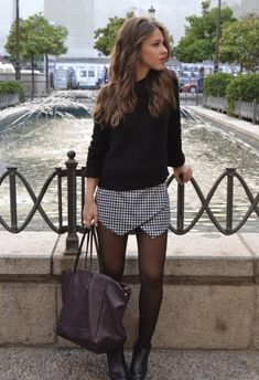 Dogstooth skort paired with black jumper = great styling