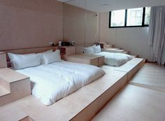 Captivating Bedroom Design Ideas with Wooden Sunken Bed and Mirror Wall