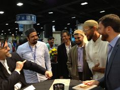 Shaykh Hamza speaking with Imam Zaid Shakir and Shaykh Walead Mosaad at the 2013 ISNA convention in Washington, D.C.
