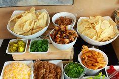 Nacho Bar Ideas - A Tasty Game Day Party Buffet - Moms & Munchkins Nacho Cheese Sauce, Graduation Party Foods, Graduation Ideas, Nacho Plate, Chili Nachos, Tortilla Bake, Dessert Nachos, Cheesy Nachos