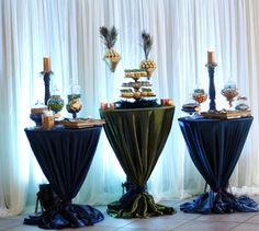 Candy Buffet - Peacock - Triple Cocktail Table Setup Love it! It's elegant, rich, dark blue. I like the tablecloths tied at the bottom better than closer to the top. It is an artistically more pleasing look for me.