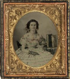 ca. 1860, [ambrotype portrait of a beautiful young woman wearing an exquisitely detailed dress, black lace gloves, and gold jewelry with applied gilding]  via Southern Methodist University, Central University Libraries, DeGolyer Library, Lawrence T. Jones III Texas photography collection