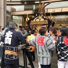 Bumped into mikoshi carriers in Nihonbashi last Sunday. A mikoshi (神輿) is a divine palanquin (also translated as portable Shinto shrine). It is believed to serve as the vehicle to transport a deity while moving between main shrine and temporary shrine during a festival. My father used to carry mikoshi from time to time not because he's a Shinto believer  but because it's just fun for him. #japan #tokyo #nihonbashi #travel