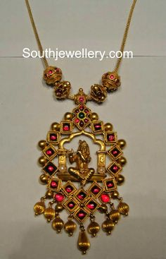 Simple antique finish temple jewellery necklace with Lord Krishna pendant studded with rubies and emeralds.