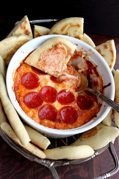 Pizza Dip served with Flatbread: This is pizza deconstructed (that means to take apart something that is made). There is ricotta cheese, shredded Italian cheese blend, marinara sauce, pepperoni slices (optional, that means you have choices). This would be great for a party or for dinner with a salad.