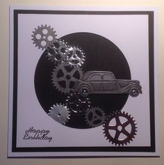 X-Cut cog dies and Marianne Designs car die on grey pearlescent card, vellum for windows, embossed and shaded with black chalk ink.