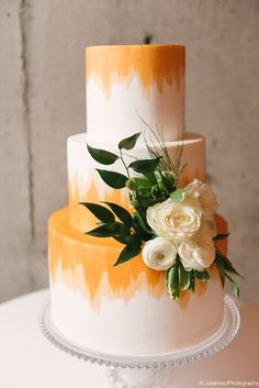 Hand-painted tangerine watercolor cake. Image copyright Julianna J Photography.
