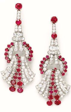 A PAIR OF RUBY AND DIAMOND EAR PENDANTS  Each designed as a circular-cut ruby and diamond scroll, to the circular link set with rubies and diamonds, with a pavé-set and square-cut diamond surmount with circular-cut ruby accents, mounted in platinum