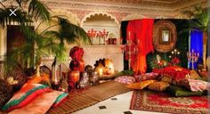 Moroccan style decor lavish exagerated traditional livingroom bedroom dining red green blue gold pillows plants candles decoration