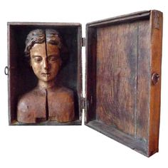 Carved head mounted in box  France  18th C  An unusual & rare carved polychrome bust mounted inside a wooden box.