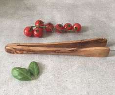 Tongs Made From 100% Natural Olive Wood Measurements: ca. 10  These salad and BBQ tongs are made from a single piece of solid, durable olive wood. They measure approximately 10 inches in length.   As a natural result of the manufacturing process, products can feature small