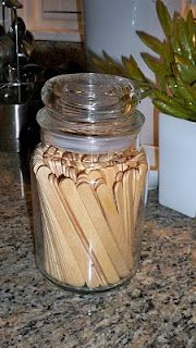 Recycle candle jars for the office or at home.  Love this idea...what about your q-tips in the bathroom...or cotton balls.  Just some of my own ideas.  :)