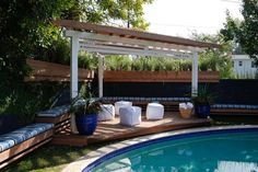 The white poufs do double duty as seating and pool toys. >>  http://www.hgtv.com/decks-patios-porches-and-pools/15-lounge-worthy-poolside-patios/pictures/page-3.html?soc=pinterest